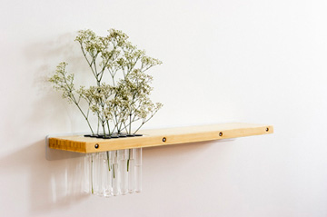 Arrange Wall Shelf Integrates Nature into the Design.
